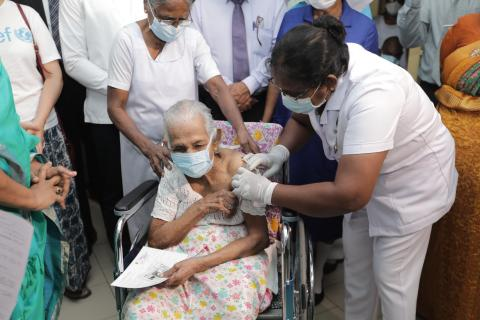 An 60+ elder receiving the AstraZeneca vaccine