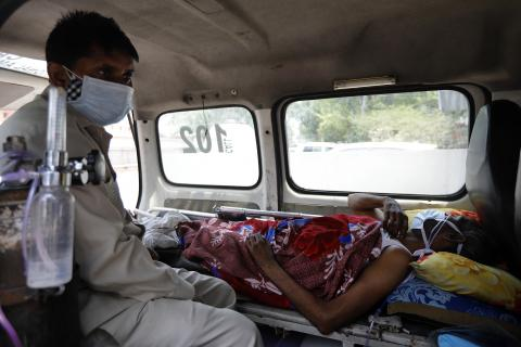 Patient waits inside an ambulance for a bed at the Lok Nayak Jai Prakash hospital in New Delhi India