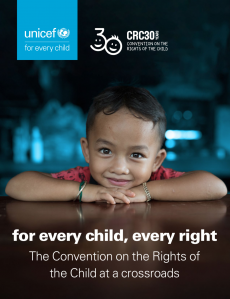"A photo of the cover image: a young boy is smiling with his hands and head on a table, the text is in the bottom third of the image: ""for every child, every right The Convention on the Rights of the Child at a crossroads"" and the CRC30 and UNICEF logos in the top third of the image."