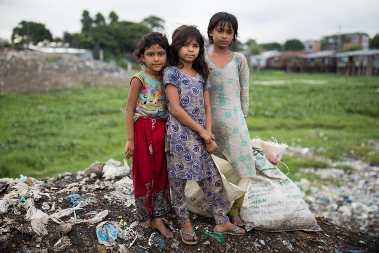 On 23 July in Bangladesh, these three girls work in their local rubbish tip in Dhaka collecting spares or recyclable items that can be recycled for other uses. From their collection they can earn money which will help buy them food for themselves and their families.