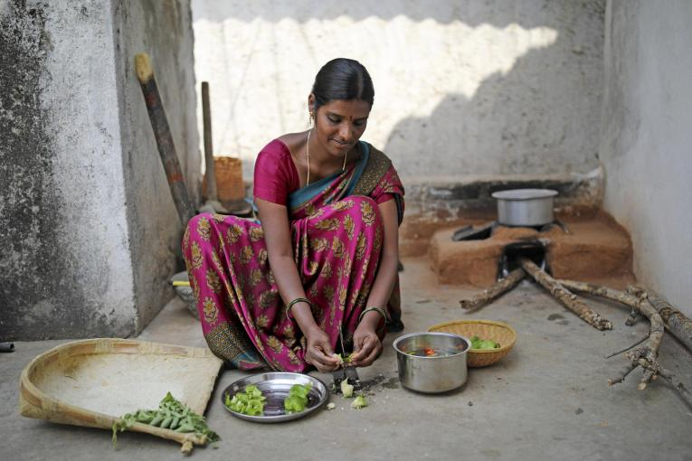 A mother preparing a meal