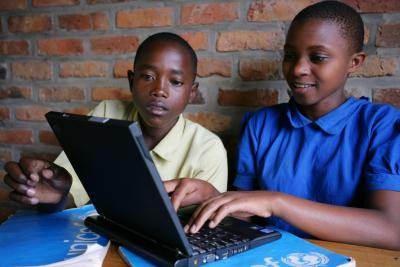 Two students in Rwanda on laptop in school