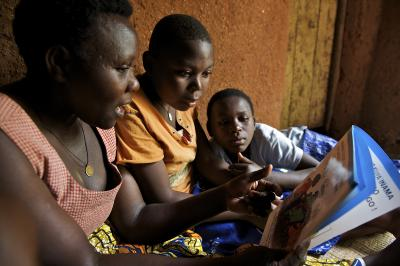 Family in Rwanda reads book with children