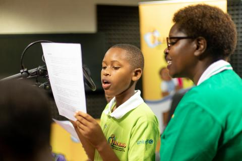 A child voice actor at the recording of Itetero radio show supported by UNICEF.