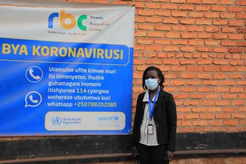 Odette Mpungirehe, a UNICEF consultant conducting risk communication and community engagement activities to fight COVID-19, stands near the market in Kirehe District, Rwanda.