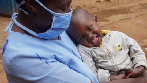 In Rwanda, a boy cuddles his mother, who wears a mask to prevent COVID-19, after receiving a healthy breakfast.