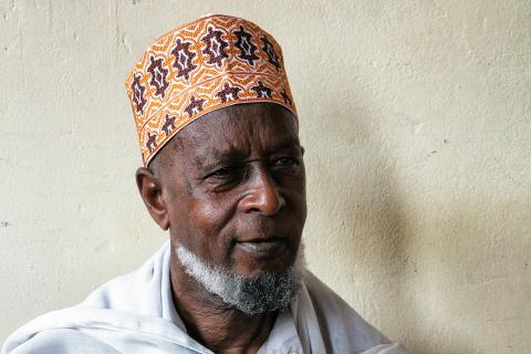 Kayijuka Asumani, 83, is an Elder at Moskit Madina in the centre of Rwanda's capital, Kigali. He has learnt a lot about Ebola prevention from Friday prayers, when the Imam peppers religious messages with Ebola awareness information.