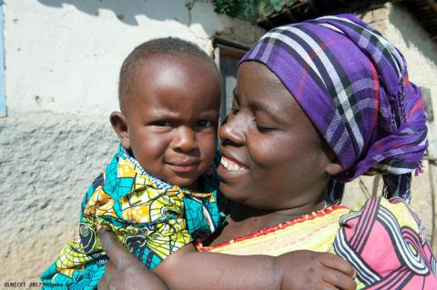 Mother and baby in Rwanda during nutrition assessment smile together