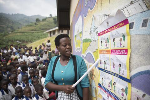 UNICEF worker in Uganda educates children and community about Ebola prevention