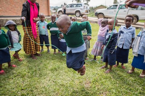 A young girl plays jump rope at an early childhood development centre in Rwanda