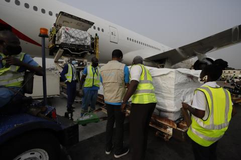 COVID Vaccines being offloaded from a cargo plane