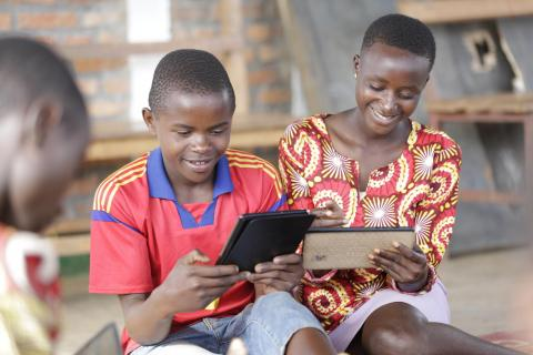 Alain, 14, plays with educational apps in a UNICEF-supported child-friendly space for Burundian refugees.