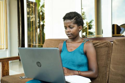 A girl using a laptop