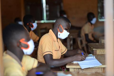 Final-year students in a Ghana classroom where masks while preparing for examinations.