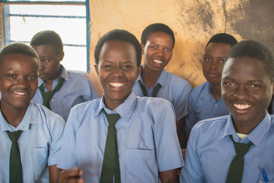 Secondary school students in Rwanda in classroom wearing uniforms