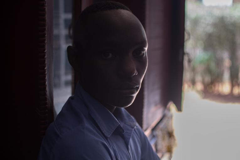Boy in Rwanda with face hidden in silhouette
