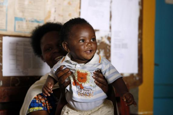 A baby at a health centre in Rwanda with his mother.