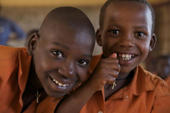 Two boy students in Rwanda smile at camera