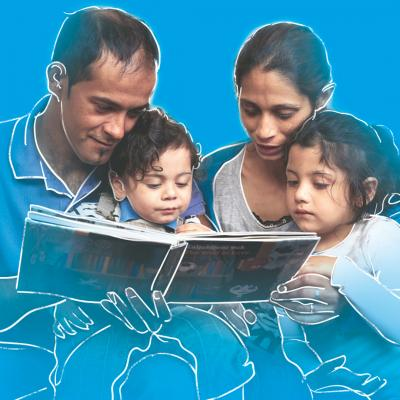 Roma mother and father reading to their children