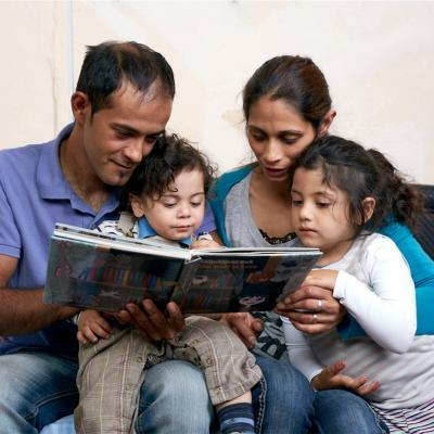Parents reading to their children.