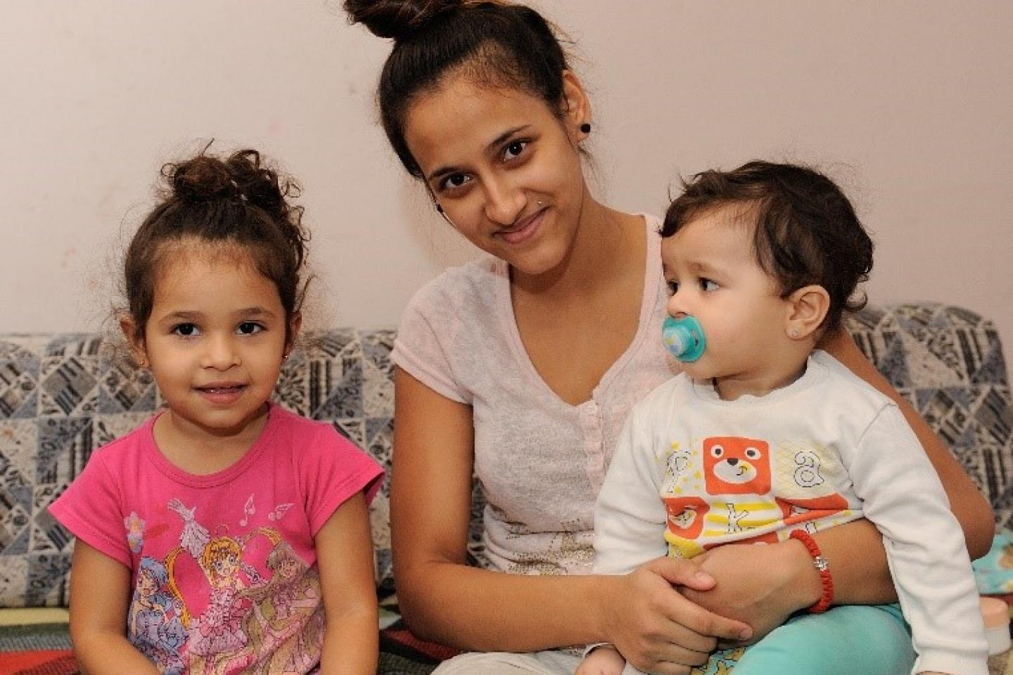 Kristina, with her two children Lejla and Dragoljub, lives in a Roma settlement in Resnik, in Belgrade.