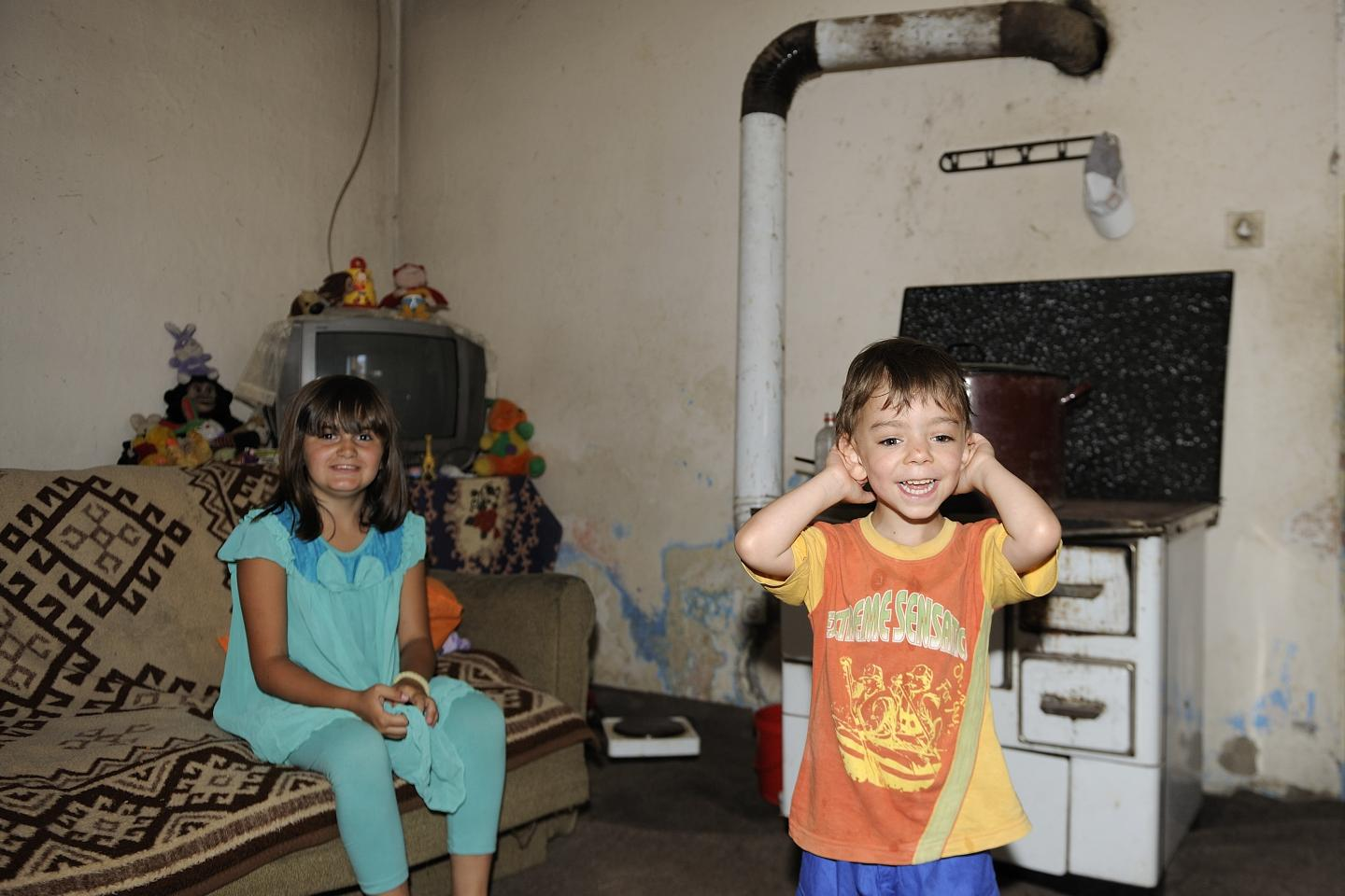 David (4) and his sister Aleksandra (9) playing in their home