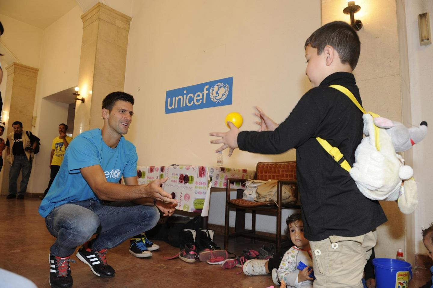 UNICEF Goodwill Ambassador Novak Djokovic plays with Boset at the UNICEF-supported child-friendly space in Belgrade.