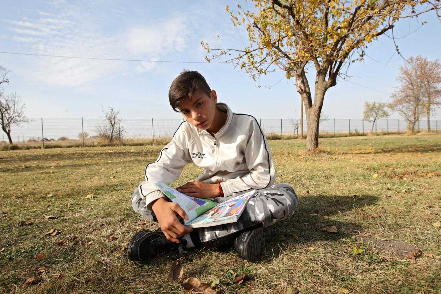 Mohamed Tajik (13) with his book in Farsi