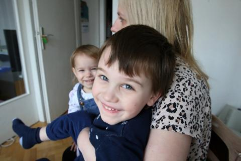 Lazar, 5, with his sister Milica, 3, and mom Anastasija.