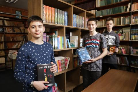 Marko, Nikola and Ilija hold their favourite books.