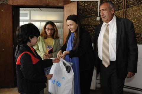 Regina De Dominicis and Ivan Gerginov distribute UNICEF kits with warm clothes