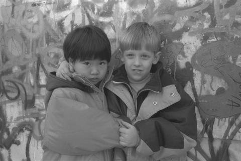 Chinese and Serbian boy posing for a photo