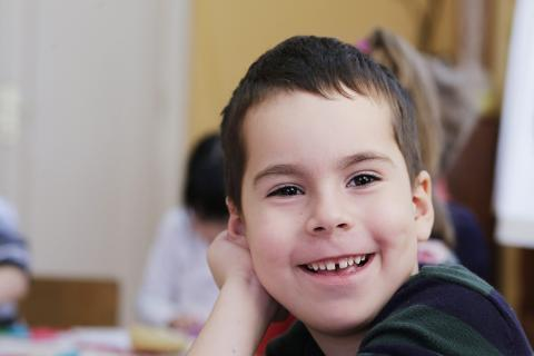 Boy smiling in kindergarten