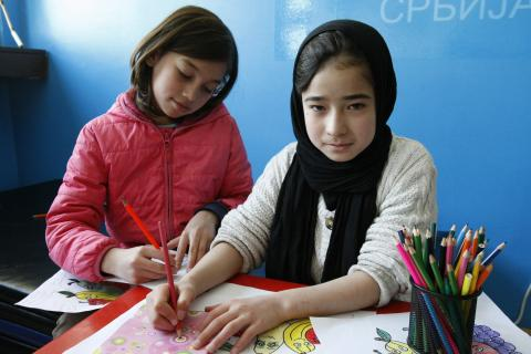 Refugee and migrant girls drawing at a reception centre