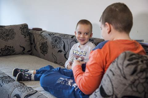 Boys with disability playing in their living room