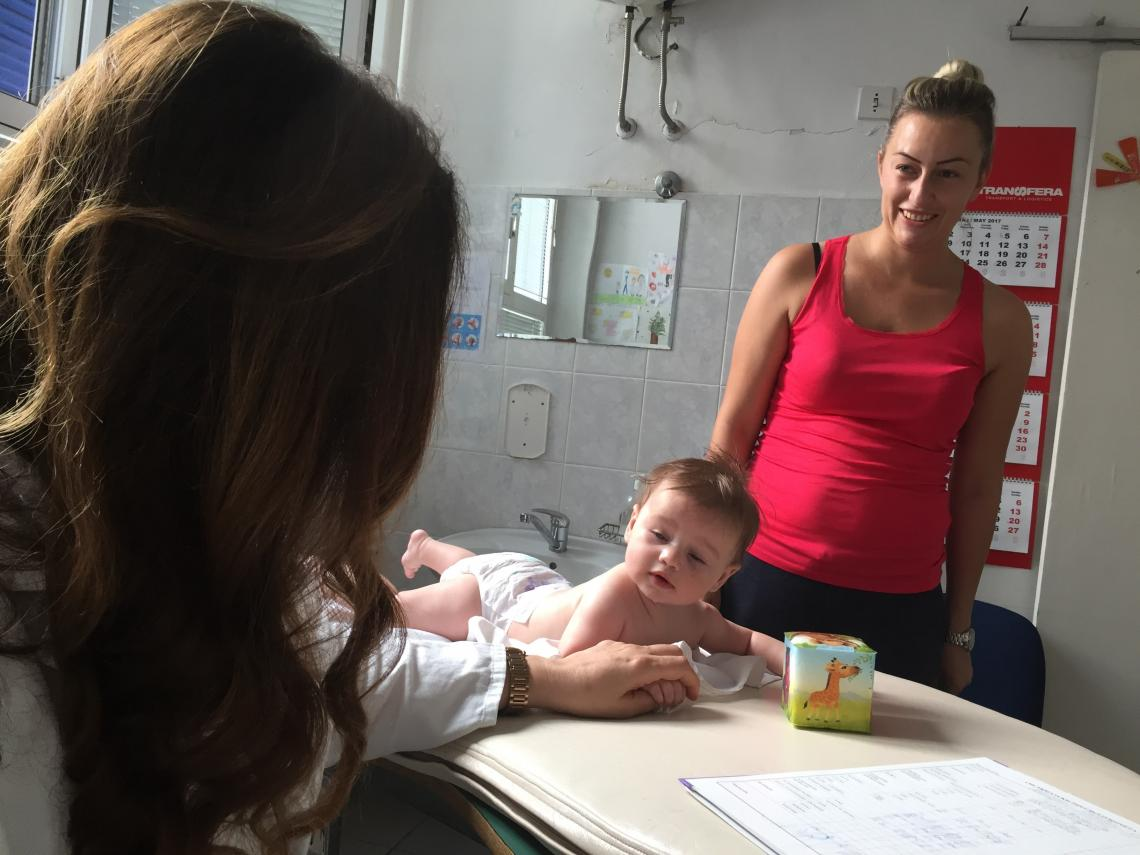 Five-month-old Natalija is having a medical check-up before receiving her vaccine.