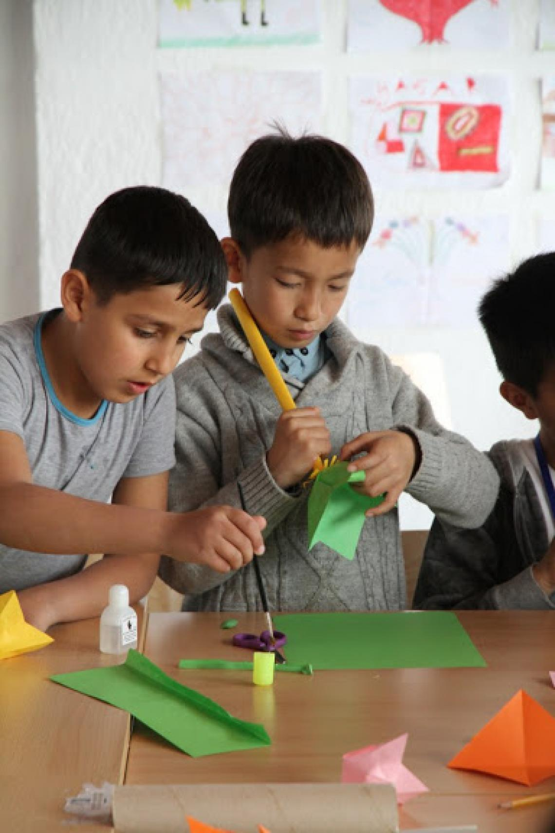 Children attend a handicraft workshop in the One Stop Centre in Presevo, Serbia.