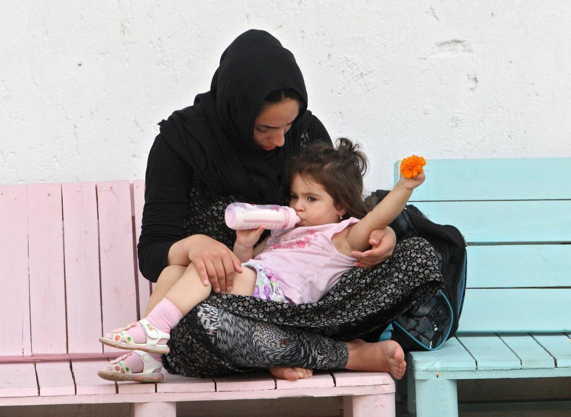 Fatima Teimuri from Afghanistan and her one-year-old daughter, Amene, during a break from workshops in the Women's Centre and the Child Friendly Space.