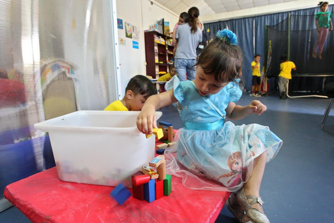Children playing with toys at the Child Friendly Space