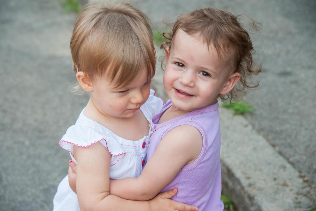 Two toddler girls playing