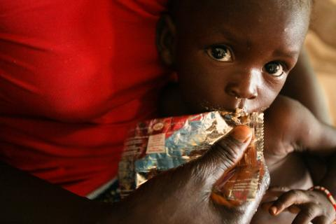 A child is fed with Ready-to-use Therapeutic food (plumpy nut) at a health facility in Sierra Leone.