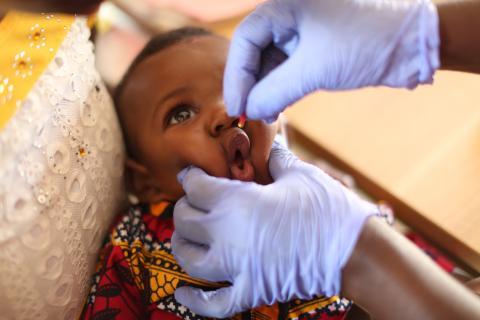 A baby receives a dose of vitamin A at the Konsho Community Health Centre in Bombali District, northern Sierra Leone