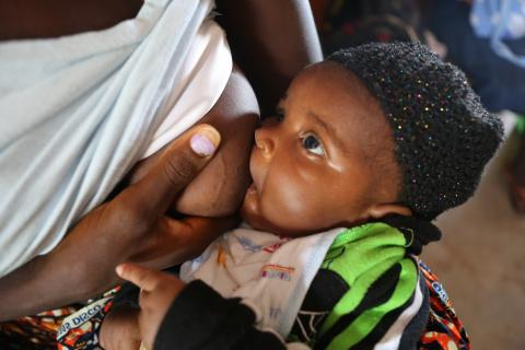 A mother breastfeeds her baby at a health facility in Sierra Leone.