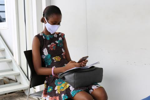 A young lady uses a mobile phone in Freetown, western Sierra Leone.