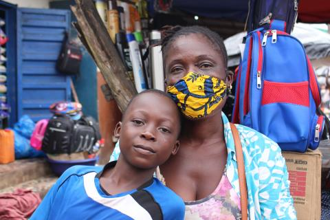 Isatu with her son Roy. Isatu relies on the sales from the market to raise her family
