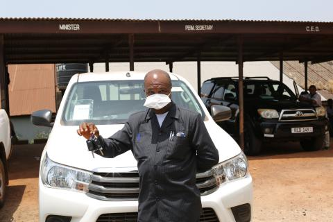 Permanent Secretary in the Ministry of Basic and Senior Secondary Education, Mr. David Banya, displays keys to two vehicles presented to the Ministry by UNICEF.