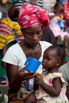 Flood affected children under five-years of age sheltering at Freetown's National Stadium receive nutritional support from UNICEF. BP-100 therapeutic food is made into porridge and distributed in individual cups to ensure hygiene.