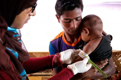 A Rohingya refugee child being examined