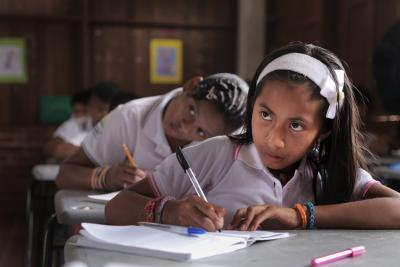 A girl takes notes in class, Colombia