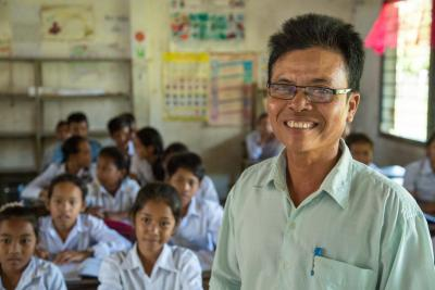 A teacher stands in front of a class, Cambodia